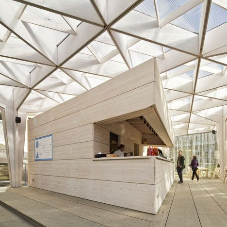 Tapered tree-like columns support a triangulated wooden canopy at this summer pavilion in Helsinki designed by Aalto University student Pyry-Pekka Kantonen
