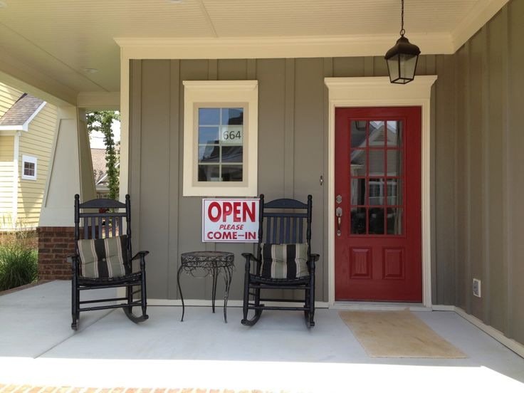 Red front door porter paint 39 brick dust 39 432 7 the winterset home in whisper creek at for Porter exterior paint