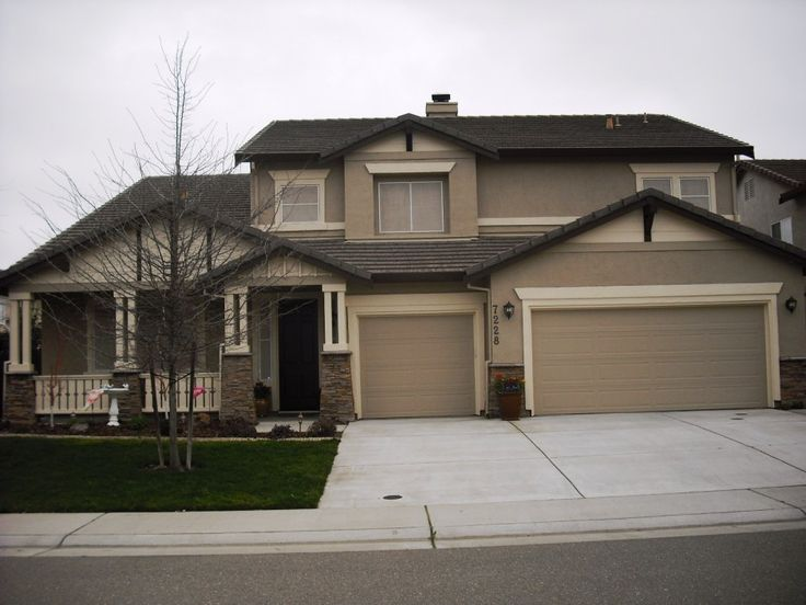 Exterior Colours: Dark Brown Roof, Creamy Trim, Mid-tone Neutral Siding - source ?