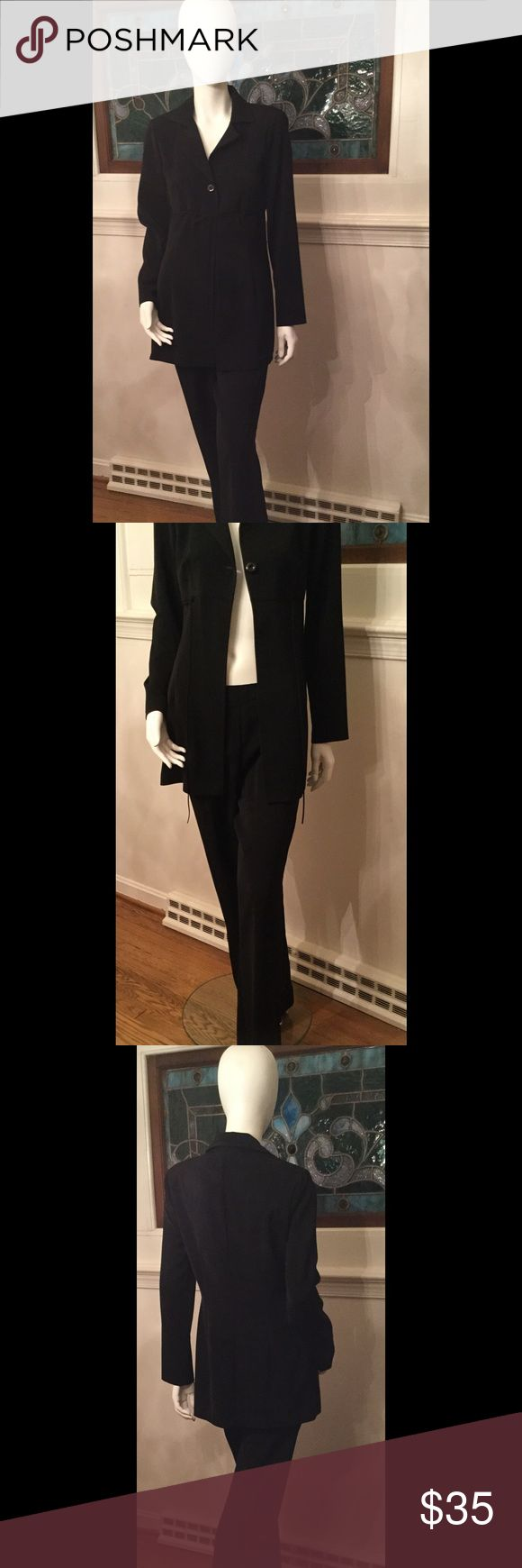 One Button Pants Suit Black Ladies Jacket/Slacks Pants Suit. One button in front of Jacket. One string tie underneath button. On the last pic.. There is a mark on the back of slacks. From the hanger clip. The Fabric feels gorgeous, it feels like a soft crepe. 100% Polyester. My Michelle Pants Trousers