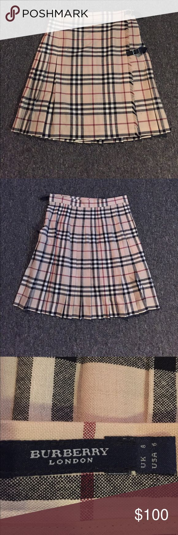 Genuine Burberry kilt. Size 6. Has flaws. This is a genuine Burberry summer weight kilt. Adjustable buckles. Kilt has minor signs of wear as shown in the fourth and fifth picture. Hardly noticeable. Beautiful kilt. Burberry Skirts