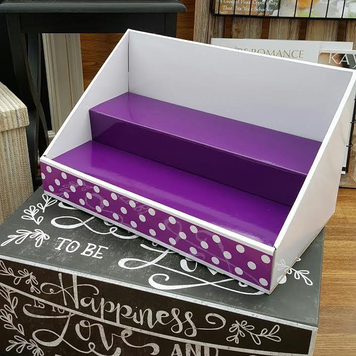 white display purple insert purple polka dot design