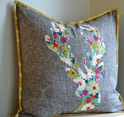 cut out deer applique on grey pillow. now i just have to learn how to do contrast piping.