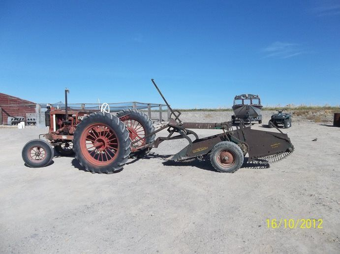 """937 Farmall F12 tractor with late 40's One Row Oliver Potato Digger still at work in Idaho. According to the owner: """"This old one row digger gets used each fall to dig a garden plot of red spuds. It is PTO driven and pulled with my old restored F12 Farmall, rated 13 belt HP."""""""
