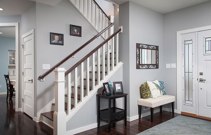 View of Foyer and stairway to 2nd floor.  Custom painted and stained stair treads with craftsman railing.
