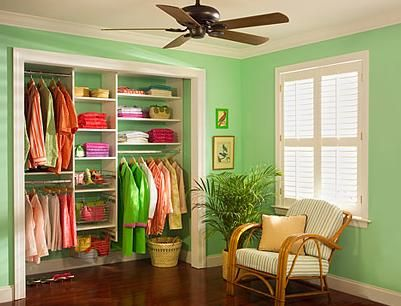 I like the contrast created by the paint on the closet's interior walls and the bright white shelves.  Good idea.