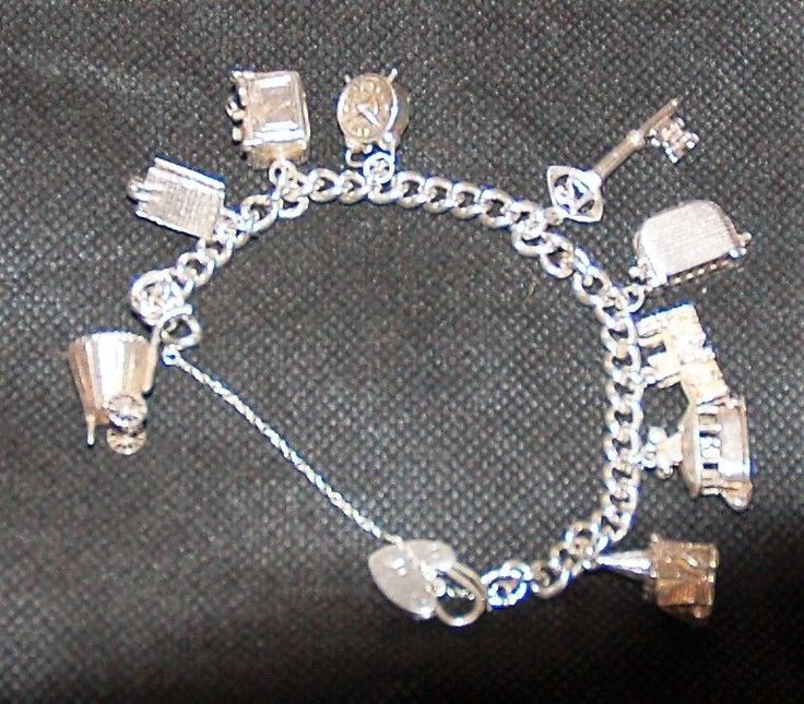 Charles Horner silver charm bracelet with 9 unusual charms.1964  | eBay