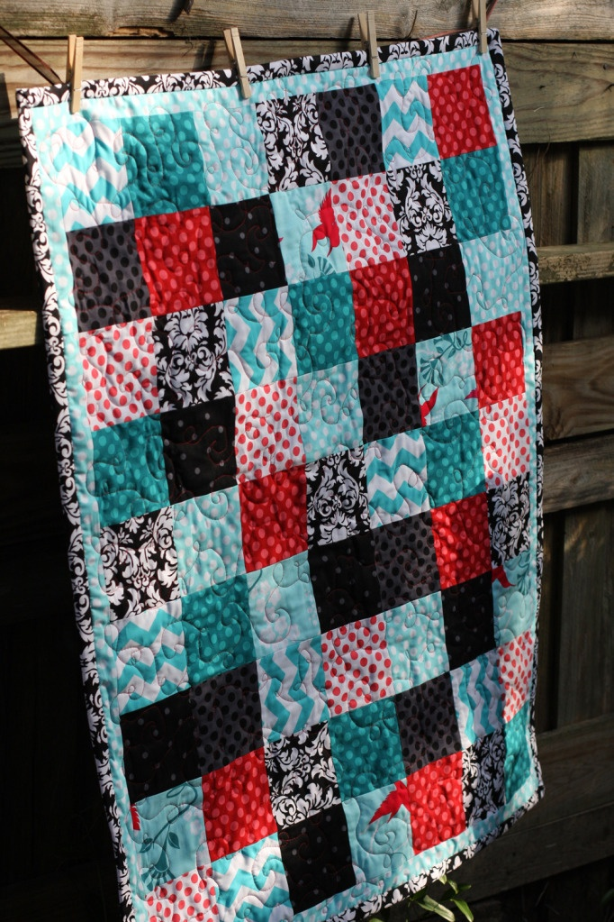 I love the fabric used in this quilt! And the skinny border
