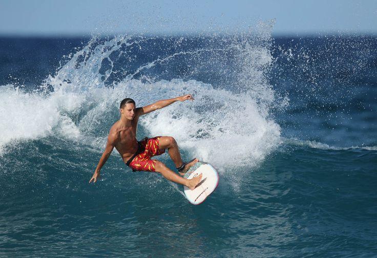 Surfer on wave https://www.camerasdirect.com.au/digital-cameras/digital-slr-cameras/canon-dslr-cameras