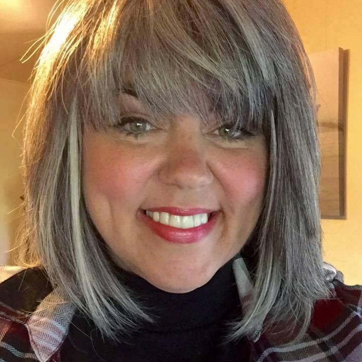 Silver gray bob haircut.  Grey hair. Mature. Aging gracefully. Granny hair.