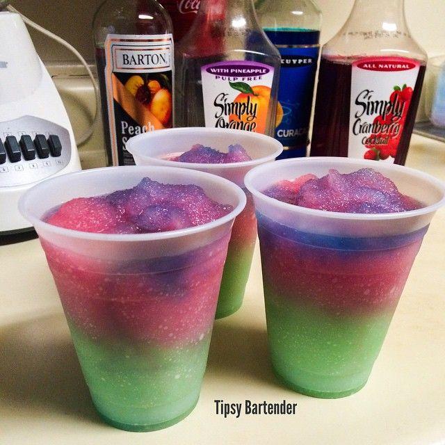 """THE DRUNKEN BARNEY Green: 2 oz. (60ml) Coconut Rum 1 oz. (30ml) Blue Curacao 3 oz. (90ml) Orange Juice Ice Blend Red: 2 oz. (60ml) Vodka 1 oz. (30ml) Peach Schnapps 3 oz. (90ml) Cranberry Juice Ice Blend Splash of Blue Curacao"" #tipsybartender"