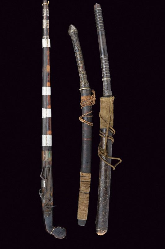 A special lot featuring a flintlock musket and pair of swords, all originating from 19th century Indochina (Southeast Asia).