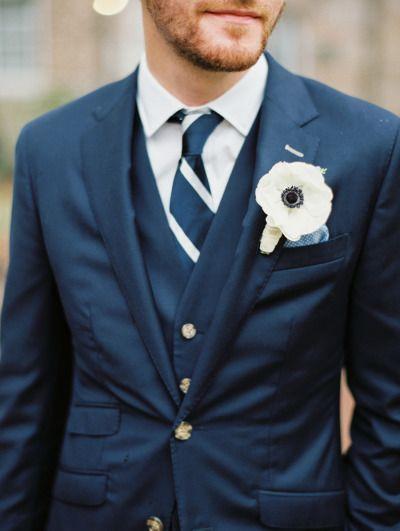Navy tux with an anemone boutonniere: http://www.stylemepretty.com/south-carolina-weddings/charleston/2015/07/15/elegant-navy-blush-charleston-wedding/   Photography: Sarah Kate - http://sarahkatephoto.com/