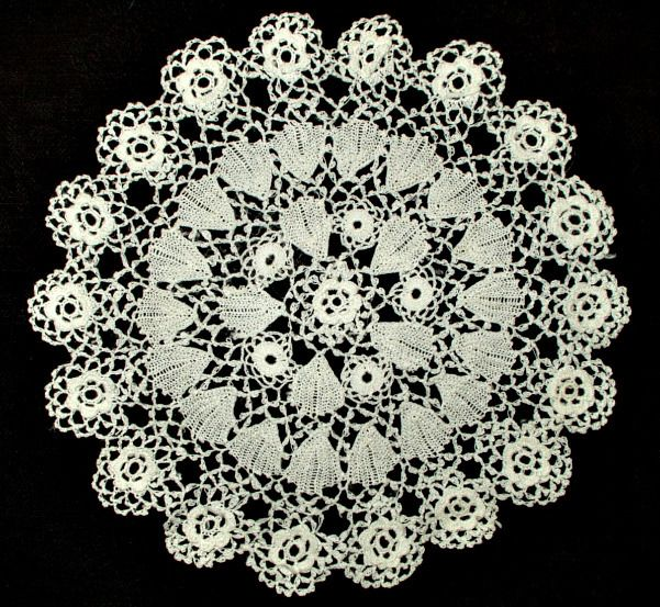 Lovely vintage Irish Crochet lace doily measuring 5 1/2 inches in diameter. Dating from the 1920's or about.  Laundered and pressed. Very nice condition.