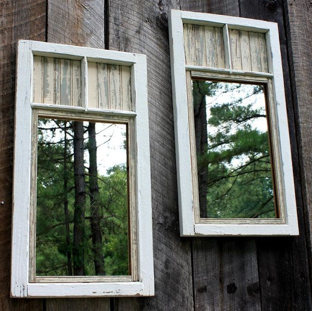 repurposed windows into mirrors -- love how they look on this rustic fence