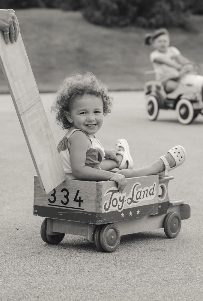 little girl in wooden toy truck modern storytelling lifestyle photography | Erin Hall Photography Hamilton ON