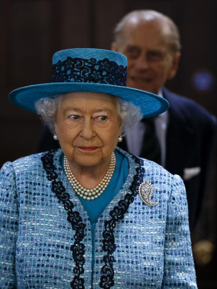 Queen Elizabeth II, with Prince Philip in the background, reopens Canada House.