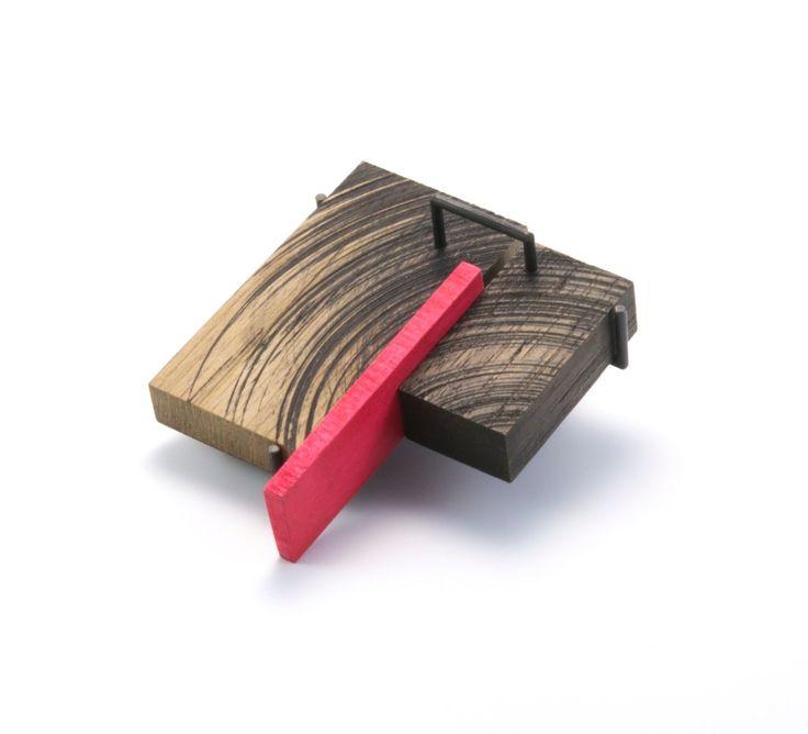 """Julia Turner """"Swipe Brooch"""", 2013. Wood, stain, steel. 1.8 x 2.4 x .4 in (4.5 x 6 x 1 cm)."""