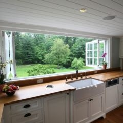 Oh my! Can you imagine cooking with that view?! Although I'd be worried about bugs getting in..