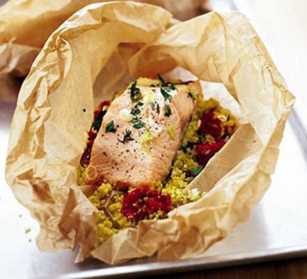 Herby salmon & couscous parcels - easy  Ingredients:  110g pack lemon and garlic couscous  200ml hot vegetable stock  1 tbsp olive oil  handful chopped fresh herbs (parsley, plus thyme, tarragon or rosemary is good)  4 spring onions , thinly sliced  4 Sun-blush or sundried tomatoes , chopped  2 salmon fillets , approx 140g/5oz each