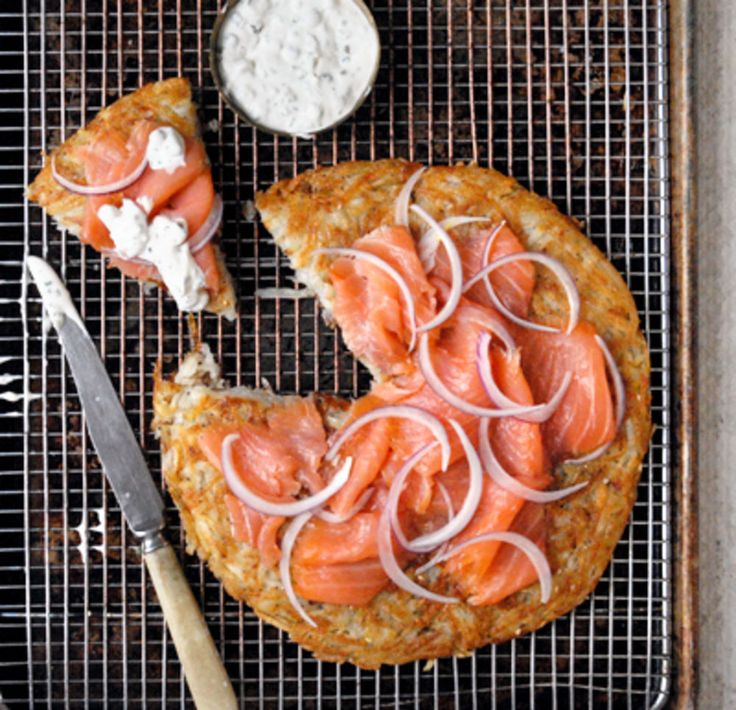 Peppered with sesame and poppy seeds, this crispy potato galette, is topped with lox and caper-crème fraîche—all the best parts of an everything bagel.