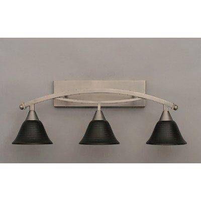 """Bow 3 Light Bath Vanity Light Finish: Bronze, Shade: 7"""" Charcoal Spiral Glass by Toltec Lighting. $297.00. 173-BRZ-452 Finish: Bronze, Shade: 7"""" Charcoal Spiral Glass Features: -Bath vanity light. -Bow collection. -Number of lights : 3. -Material : Glass. -Manufacturer provide one year warranty. Specifications: -Backplate dimensions: 4.25"""" H x 16"""" W x 1"""" D. -Overall dimensions: 11.25"""" H x 10"""" W x 29"""" D."""