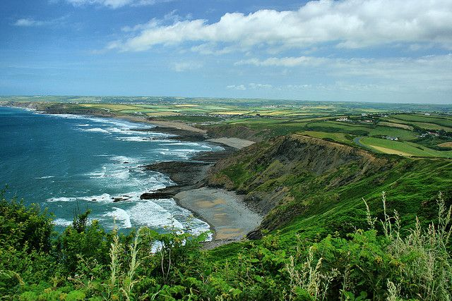 """Widemouth Bay, north Cornwall south of Bude .  This scene looks a bit like the beach on the cover of """"That Summer in Cornwall""""--minus """"Barton Hall"""" sitting on the cliff!"""