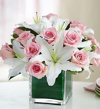 pink and white flower arrangements. Make those stargazer lilies and i'll be set.
