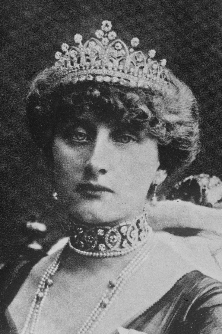Diamond belle epoque tiara, 1890, by Boucheron, made for Queen Augusta Victoria of Portugal, née Hohenzollern Sigmaringen. This tiara has several names, 'The Lily of the Valley Tiara', 'The Muguet Tiara' and 'The Maiglockchen Diadem'. Designed as a series of eight diamond arches, with lily of the valley flowers within, large circular diamond spacers, and a central large 'stem' of diamonds..