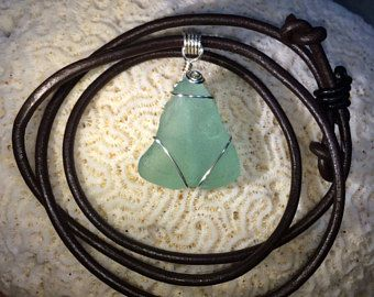 Chunky aqua sea glass pendant with thick brown leather strap, black leather sliding knot, and silver plated wire wrapping design -    #seaglass #pendant #necklace #aqua #bridal #beach #caribbean #beachware