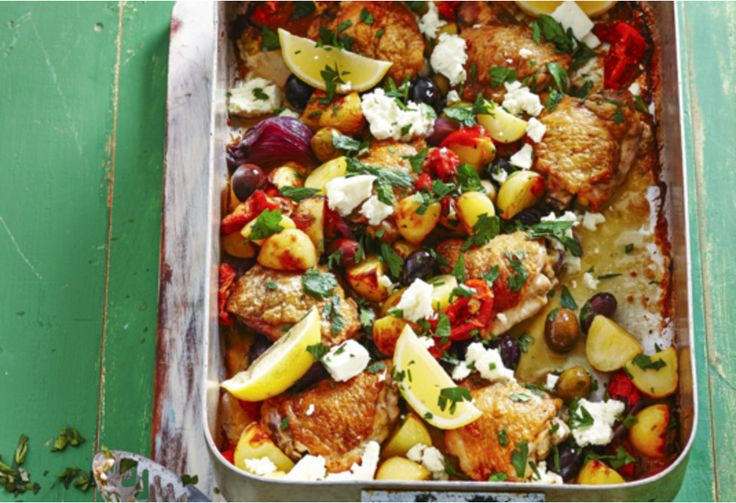 Mixed marinated olives, semi-dried tomatoes, fresh feta and garlic potatoes make for one exciting chicken tray bake.