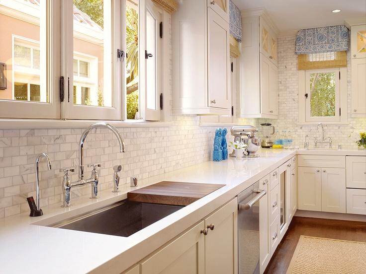 tile kitchen backsplash small traditional kitchen design white cabinets brown flooring over sink cutting board white kitchen furniture