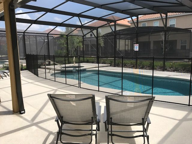 Pool Safety Fence Installed At A Disney Area Vacation Rental In The Solterra Resort In Davenport Fl Call Life Saver Poo Pool Fence Pool Central Florida Pools