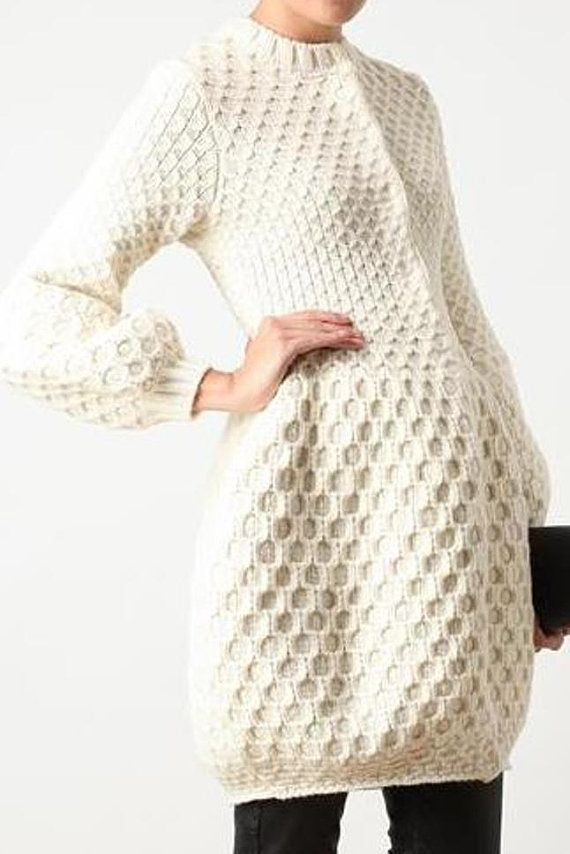 Tunic cardigan with honeycomb stitch, puffy set-in sleeves. Made with 100% Wool. Shown in Off-White yarn.    Available in Size S, M, L, (Plus Size