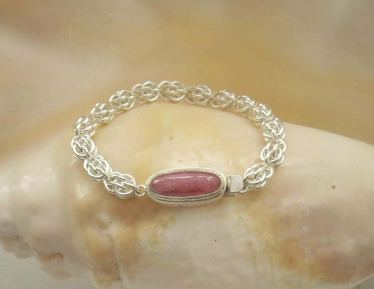 pretty pink. i'm a sucker for bracelets Bracelet: Sterling and Rhodochrosite Box Clasp on a Handmade Argentium Silver Chain Maille Bracelet. $130.00, via Etsy.