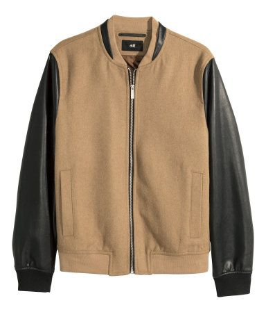 CONSCIOUS. Baseball jacket in a brushed wool blend with imitation leather details and sleeves. Baseball collar, zip at front, side pockets, one inner pocket, and ribbed cuffs and hem. Lined. Wool content is recycled.