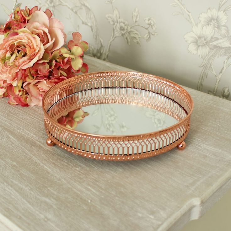 Ornate Copper Mirrored Plate A mirrored plate tray in a beautiful, bright copper colour Perfect for displaying candles, ornaments and trinkets These would add a touch of glitz and glamour to your room and could also be used as wedding table centres A great idea for wedding table centres to add that touch of glamour