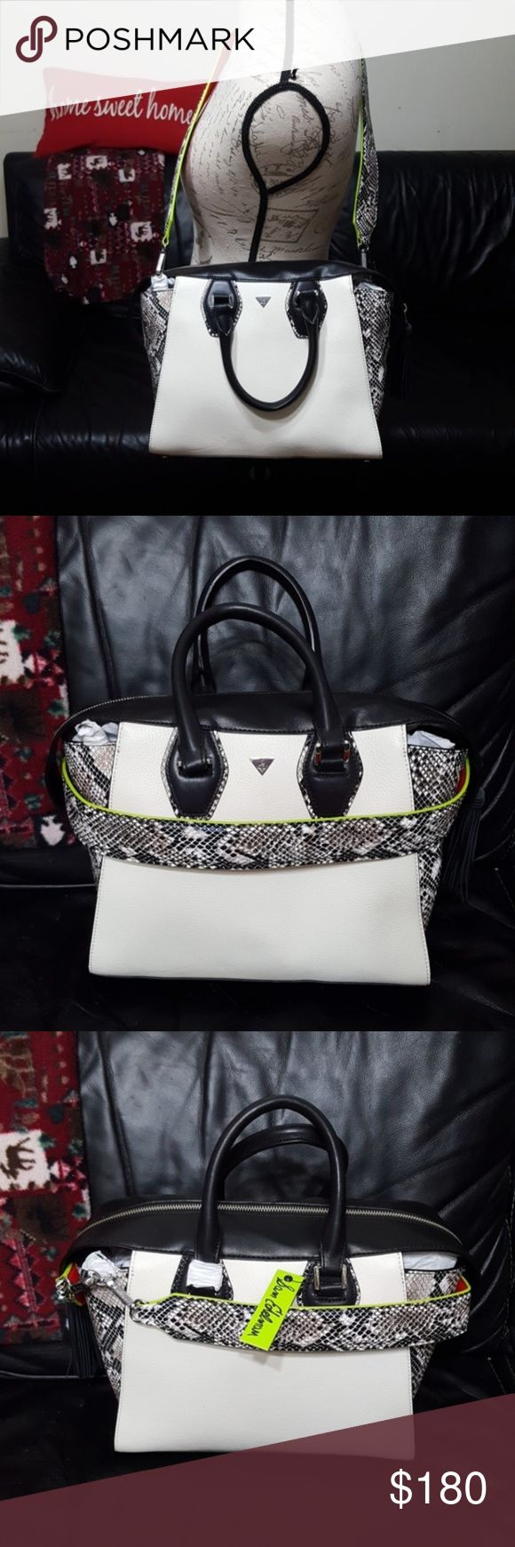 """Sam Edelman Jodie Trapeze tote in Winter White NWT, still has the tissue paper stuffing inside . Absolutely gorgeous Sam Edelman purse in Winter White with faux snake print with red and green accents. Tassel on the zipper closure. Has 3 inner pockets, 1 zippered and the other 2 open. The long strap can be used, taken off completely or can be wrapped around the bag as added decor. Dimensions: 12.25"""" width x 11"""" height x 5.5"""" depth. Sam Edelman Bags Totes"""
