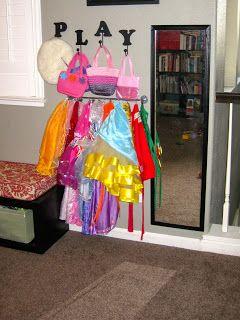Easy DIY kids' dress-up station in playroom using IKEA Bygel rail and Riktig hooks