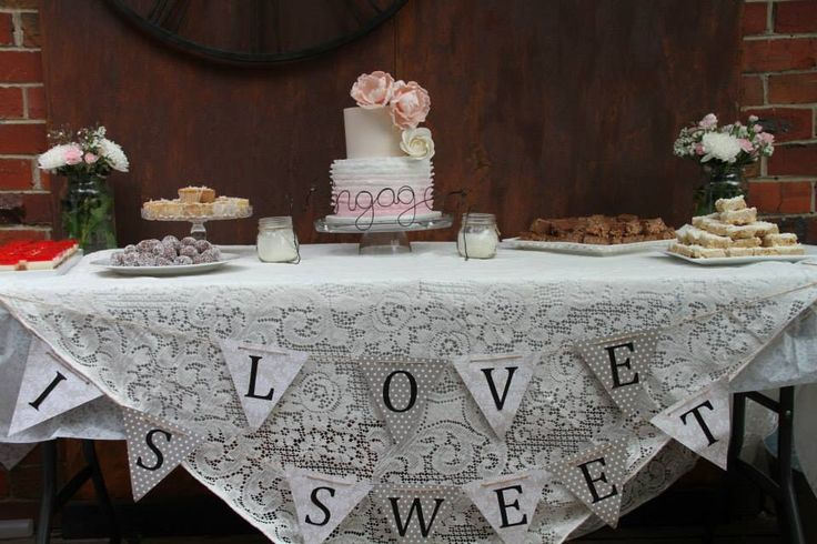 LOVE IS SWEET SIGN. I made this by simply buying a printed a4 that I liked from my craft shop I think ruled our triangles on the paper and then a double whole punch at the base of the triangle. I then printed the letters I wanted on white a4 paper and cut out each letter individually and pasted them on. I brought it all together with brown string! Rustic, beautiful and an effective touch to an event