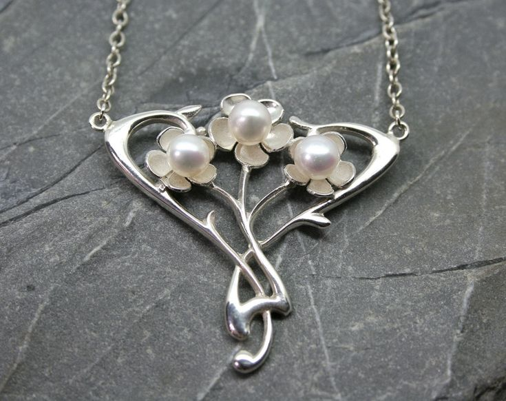Sterling silver Art Nouveau styled pendant featuring three flowers, each set with a single freshwater pearl. #artnouveau #necklace #pearl #pendant #silver #jewellery #cornwall #uk #gb #westcountry #devon #england #silversmith #pretty #jeweller #jewellers #handmadejewellery #handmade