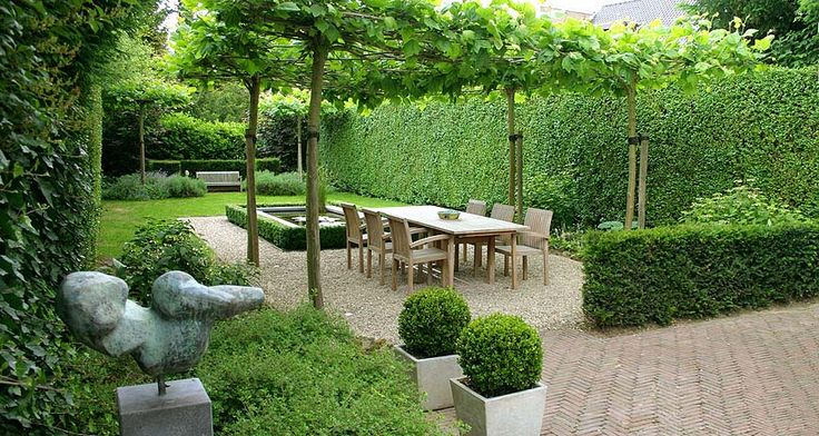 Good use of topiary creating an outdoor dining room.