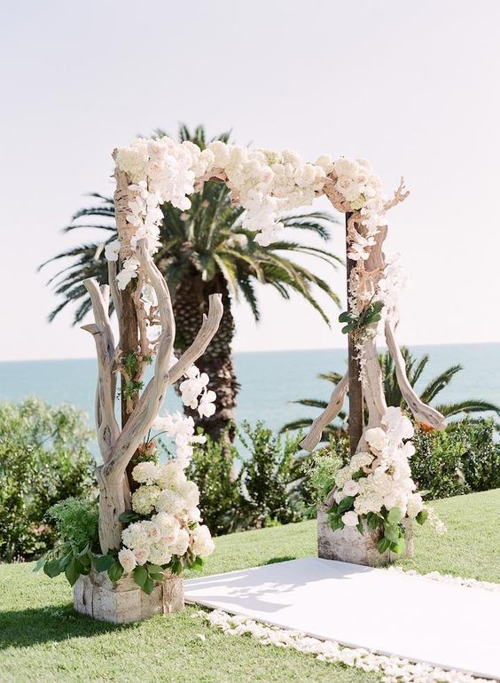 rustic beach wedding ceremony arch idea / http://www.himisspuff.com/wedding-backdrop-ideas/8/
