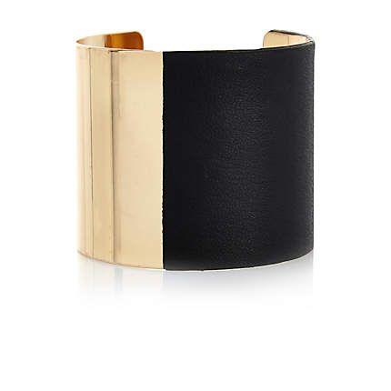 Black two-tone cuff bangle �8.00