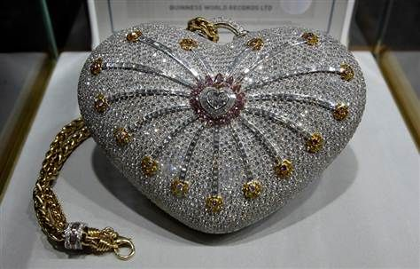 """1001 Nights Diamond Purse"""" is valued at $3.8 million. The heart-shaped bag is encrusted with more than 4,517 diamonds  – 105 yellow, 56 pink and 4,356 colorless. The diamonds on the bag weigh a whopping total of 381.92 carats. $3.8 million"""