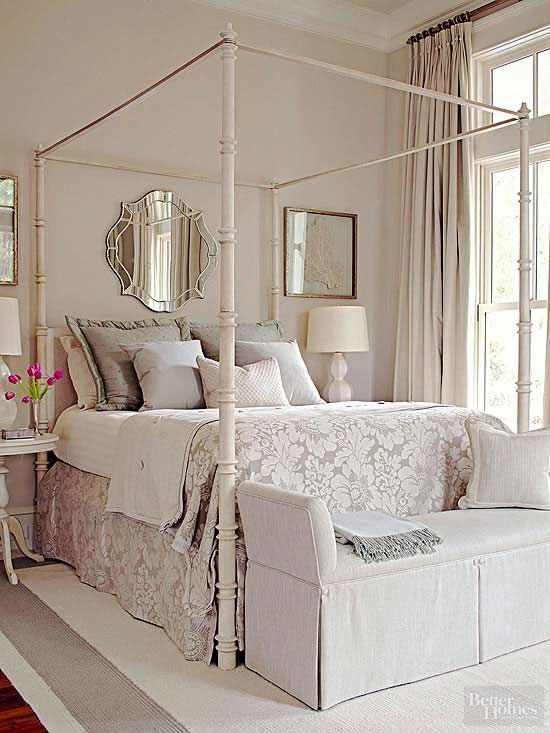a neutral color scheme helps emphasize the soaring height of this bedrooms ceiling the warm - Calming Bedroom Color Schemes