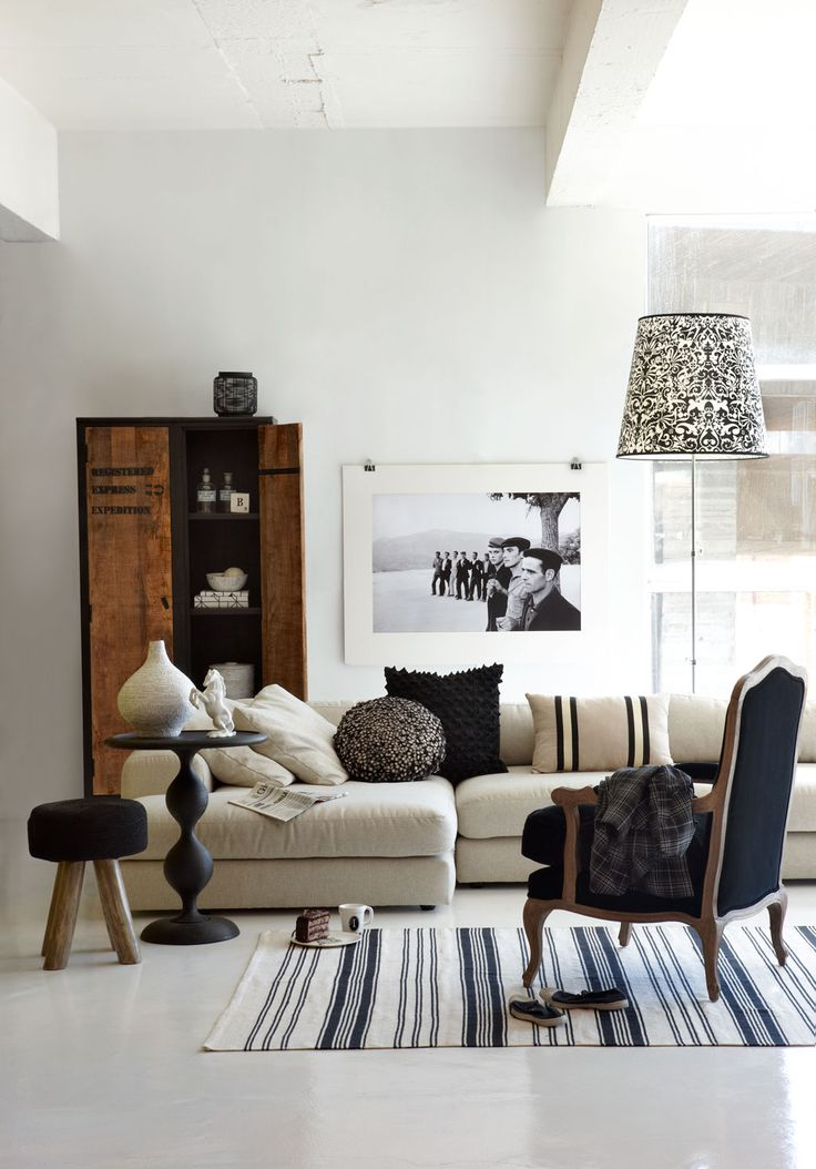 cabinet \ art \ neutral palette \ floor lamp \ side table \ occasional chair \ furniture \ light fixture \ eclectic \ styling \ living room