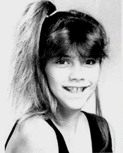 Victoria Beckham  the only picture, at any age, I have ever seen that she was smiling.