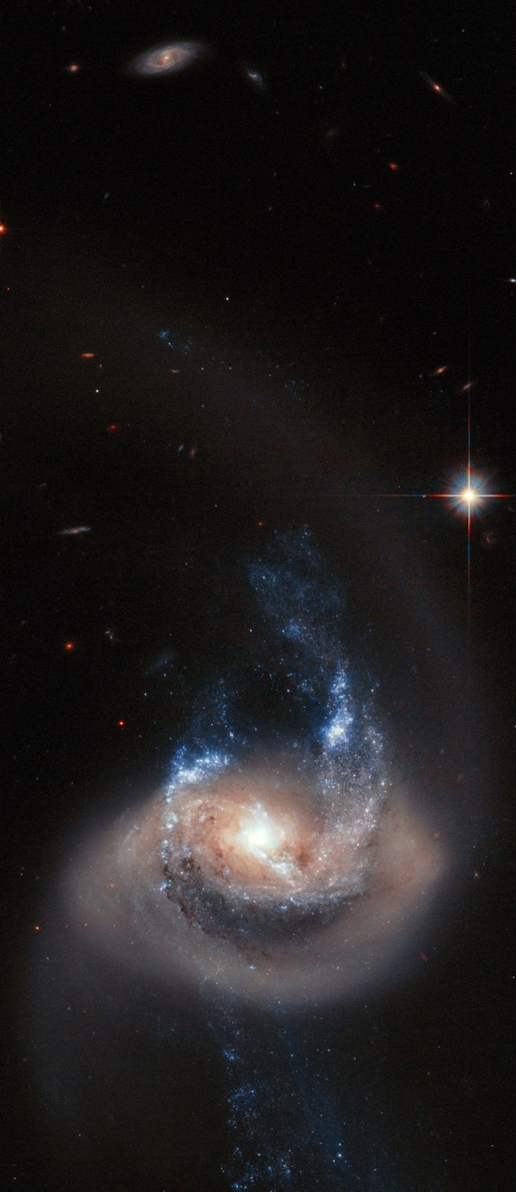 NGC 7714 ~ This unusual structure is a river of Sun-like stars that has been pulled deep into space by the gravitational tug of a by a passing galaxy, not seen in this Hubble Space Telescope photo. That's because the near-collision between the galaxies happened at least 100 million years ago.