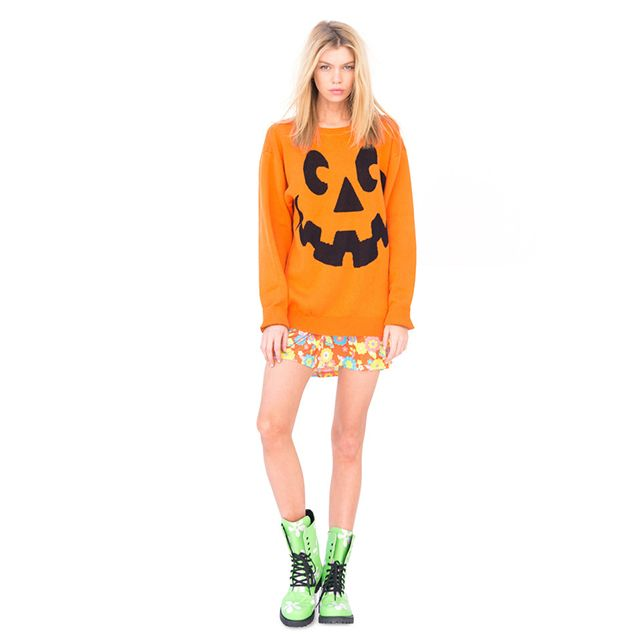 Halloween is coming! Get ready to celebrate with this warm sweater featuring Jack'o Lantern's face!